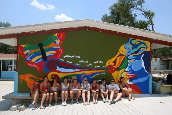 The half of the team who painted this mural.