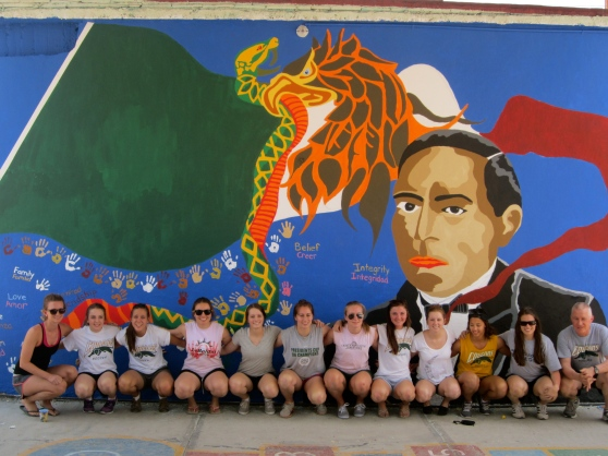 The half of the team who worked on this mural.