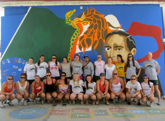 The whole team with the first mural.