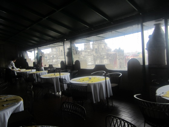"""Restaurante """"La Terreza"""" with the cathedral in the background."""