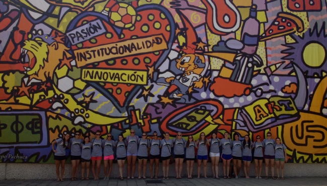 In front of the mural at Club Pachuca