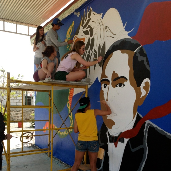 Some of us working on the Benito Juarez mural with the head artist, Herman.
