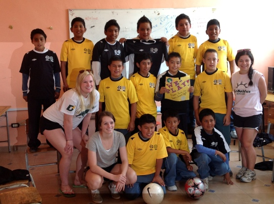 A few of the girls with one of the boys soccer teams we donated uniforms to.