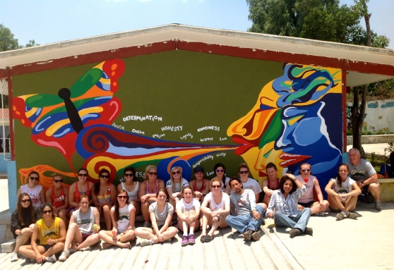 The whole team along with the head artist and his assistant, who helped up more with this mural.